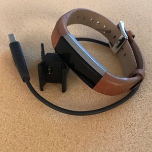 Fitbit Ulta with leather band and charger